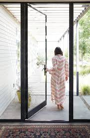 Woman Walking Out Door Of Modern Design Home Download this high ...
