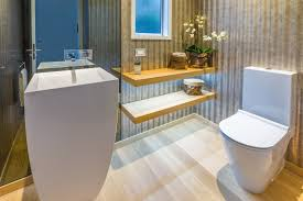 a wall height smoked glass mirror behind the sculptural bathroom floor interior design
