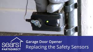 replacing the safety sensors on a garage door opener you