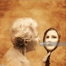 woman holding hand mirror. Elderly Woman Holding Hand Mirror Reflecting Young (Composite) : Stock Photo O