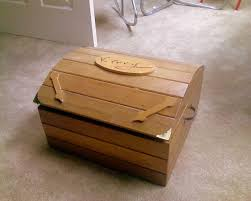 a memory box made of tan colored wood to hold memoirs of the deceased
