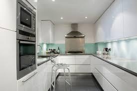 White Lacquered Pro-Kitchen @ Le OXXFORD Penthouse modern-kitchen