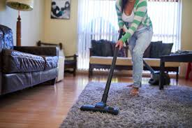 clean living room. Woman Vacuuming Her Living Room Clean L