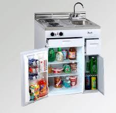 tiny house fridge. A Tiny House Kitchen Setup Complete With Everything From The Stove, Refrigerator, Storage \u0026 Fridge