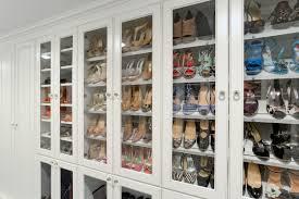 custom closets. Wall Of Shoes Behind Glass Doors Custom Closets