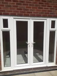 white upvc french doors with glazed side panels