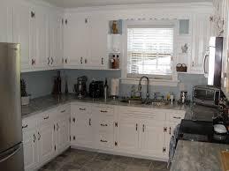 white kitchen black countertops hardware