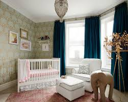 mint green and gold nursery wallpaper with corner crib