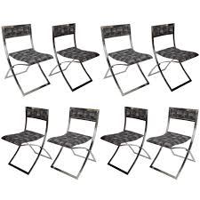 set of eight stainless steel folding dining chairs luisa by marcello