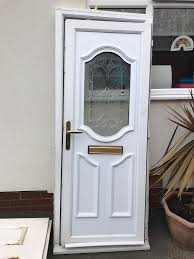 white moulded pvc door with cut glass insert frame