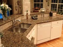 bainbrook brown baltic brown granite countertops with antique white cabinets