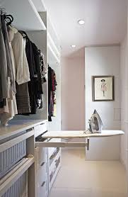 pullout ironing board is an ideal space saving solution for small walk ins