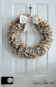 create a gorgeous wreath out of repurposed book pages tutorial at knickoftime net