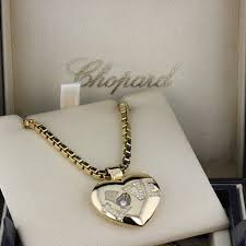 18ct yellow gold love heart pendant pave set with diamonds to form the word