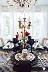 gothic dinner party with candelabras and crystal chandelier in elegant dining room