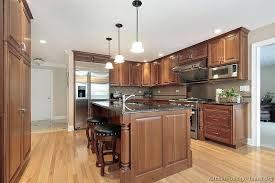 brown cabinets kitchen with black countertops light backsplash countertop