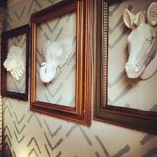 faux taxidermy animals inside vintage frames