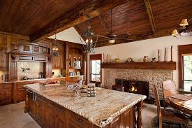 rustic kitchen with classic stone fireplace design usi design remodeling