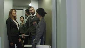 people in elevator. group of people on elevator. business women and man talking, manager with secretary, in elevator