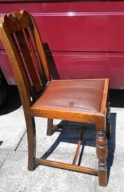 old wooden chair with leather seat vintage
