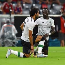 Image result for Mohamed Salah, left, and Sadio Mane celebrate after scoring a goal for Liverpool against Bayern Munich. Getty Images