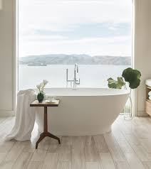 alissa freestanding oval tub with built in pedestal slotted overflow and modern tub filler