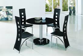 planet black round glass dining table with alison chairs