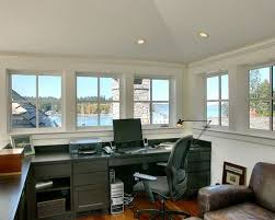 garage with office above. traditional builtin desk home office idea in seattle with white walls garage above h