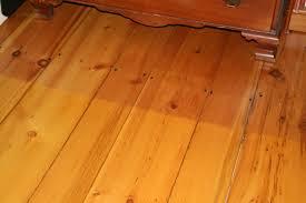 pine flooring with sun demarcation line