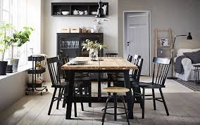 black dining room furniture sets. The Acacia SKOGSTA Dining Table Is Positioned In Centre Of A Beige And Black Room Furniture Sets H
