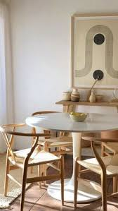 tulip table wishbone chairs and hand made ceramics