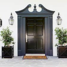 black front door with blue moldings