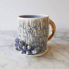 The combination of ceramic cups with ceramic fingers. Custom Ceramic Coffee Mugs Doubles As Sculptural Works Of Art