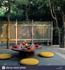 japanese patio furniture. Yellow Cushions Around Circular Table In Japanese Style Patio With Wooden Fenc Furniture L