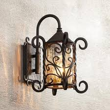 a wrought iron spanish style outdoor light at lamps plus