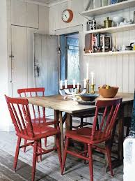 i love the simple wooden table paired with red wooden