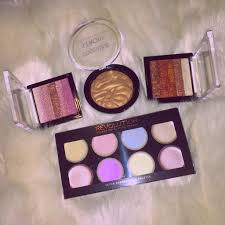 makeup revolution shimmer brick in rose gold and pink kiss strobe highlighter in gold addict and ultra strobe balm palette