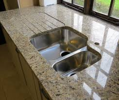 best sinks for kitchens changing a faucet granite countertops santa cecilia stainless steel movable kitchen island a flower vase