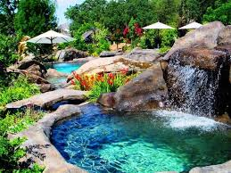 Natural looking in ground pools Above Ground Swimming Poolbeautiful Pool Waterfall With Decorative Rock Garden Decorating Idea Plus White Patio Umbrella Design Natural Looking Swimming Pool Designs Blog Zigersnead Architects Swimming Poolbeautiful Pool Waterfall With Decorative Rock Garden