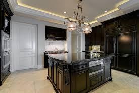 beautiful black cabinet kitchen with wolf 6 burner range black granite counter and white subway