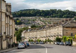 Bath. Aerial view of a semicircular terrace of houses with matching fronts  but a variety of different
