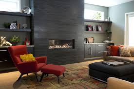 modern inspired living room with prominent dark stone fireplace