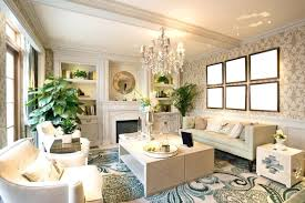 a bold white and blue living room with beautiful crystal chandelier above the coffee table between