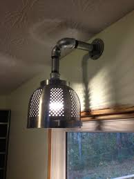 another ikea hack pretty cool kitchen light made from an ordning colander and some galvanized