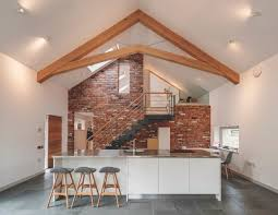 extension cost calculator inside of a timber frame extension with white scheme and high ceilings
