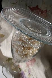 1 one wine glass pearls and plate