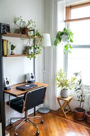 small work office decorating ideas desk near a bright window with lots of surrounding plants home interior design services image small office decorating ideas m17 small
