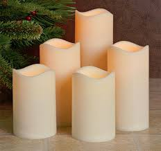 set of 5 flameless outdoor bisque resin candles 5 hour timer batteries included