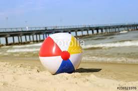 Beach ball in ocean Waves Colorful Beach Ball On Sand And Waving Sea Holiday Beach Ball Near Baltic Sea And Palanga Bridge In Horizon Colorful Beach Ball On Sand And Waving Sea Holiday Beach Ball Near