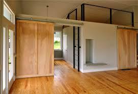 Wondrous Minimalist Loft Ideas With Wide Wooden Single Barn Doors Interior  Also Oak Wooden Floors Installation